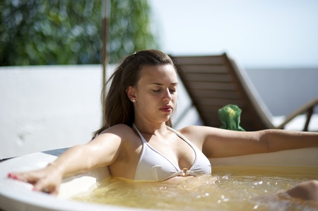 hydromassage: Woman relaxing in a hydromassage bath in Santa Catarina, Brazil