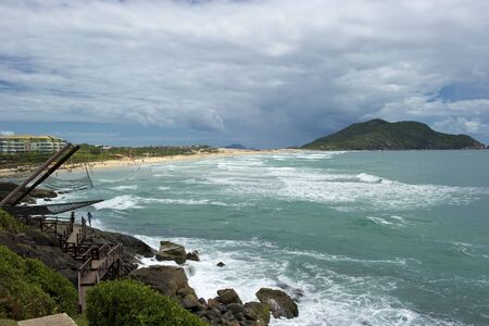 Praia do Santinho is a beach in north Florianopolis, Santa Catarina state, Brazil, located about 40 kilometres from the centre of the city. Praia do Santinho was earlier known as Praia das Aranhas and is still called by that name by many local people and Stock Photo - 11844207