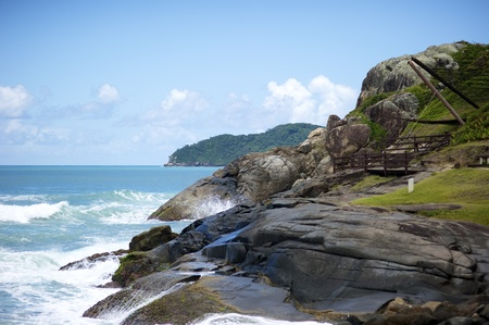 kilometres: Praia do Santinho is a beach in north Florianopolis, Santa Catarina state, Brazil, located about 40 kilometres from the centre of the city. Praia do Santinho was earlier known as Praia das Aranhas and is still called by that name by many local people and  Stock Photo