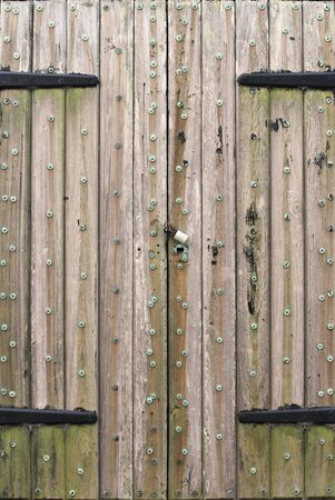 An old fort door  Weathered and padlocked Stock fotó - 13443818
