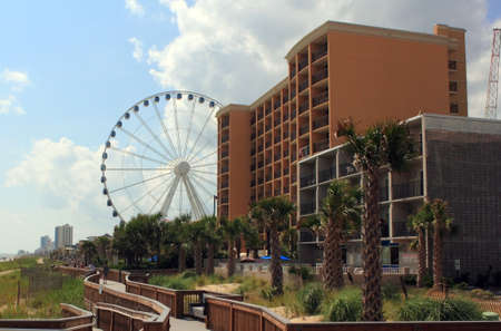 grand strand: Myrtle Beach, South Carolinas boardwalk and hotels with skywheel in the background