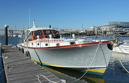 keel: a boat sits at dock in marina Editorial