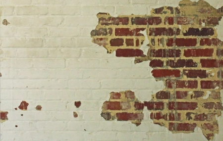 textured wall: An old and chipping brick wall