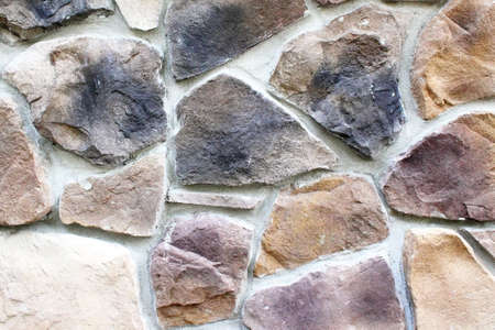 A wall of fieldstone of differing size, shape and color. Can be used as background Stock Photo - 14877898