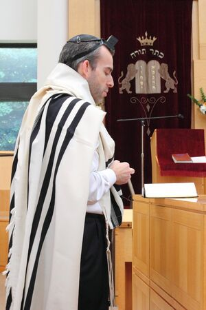 A Rabbi reads a prayer during a Barmitzvah service on August 19th 2012 at the Ketter Torah Synogogue in Englewood, NJ Stock Photo - 14833924