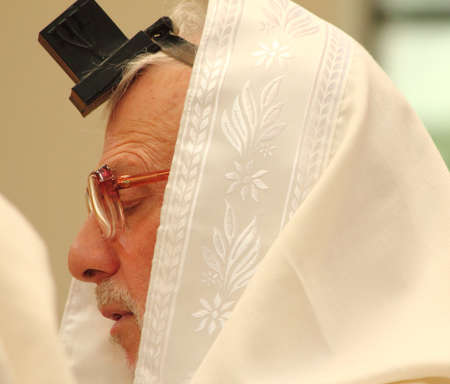 mitzvah: A deeply religious man prays during a bar mitzvah on August 19th 2012 at the Ketter Torah synogogue in Englewood, New Jersey