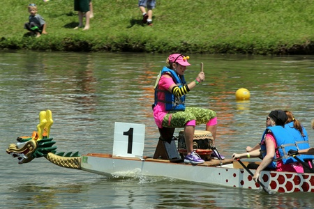 dragonboat: A drummer drives her team at the Ground Zero Dragon Boat Races in Myrtle Beach, SC USA on Saturday April 27, 2013.
