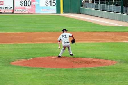 pitchers mound: A baseball pitcher delivers a pitch from the mound  Editorial