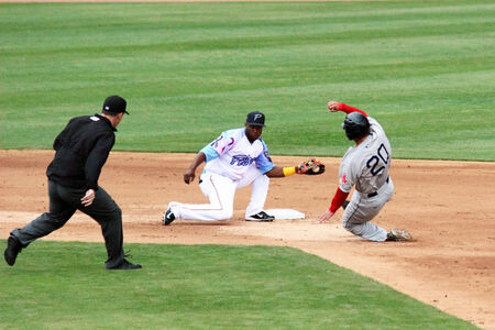 attempting: A runner slides into second attempting to steal second base  Editorial