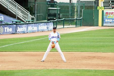 baseman: A third baseman takes up his position on the baseball field.