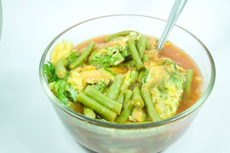 Sour soup made of tamarind paste with scramble egg and vegetable photo