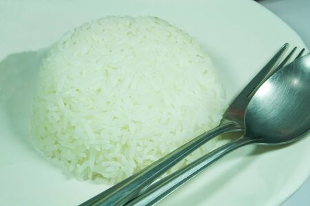 Bowl of Rice on White Background photo