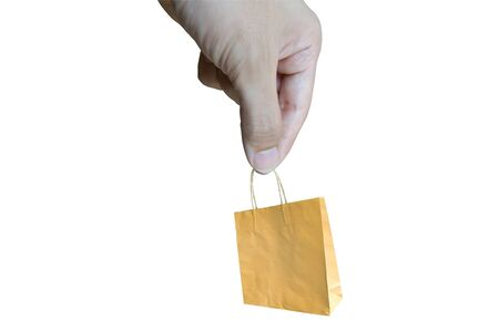 Human holding a brown paper bag in his hand  Stock Photo - 13149526