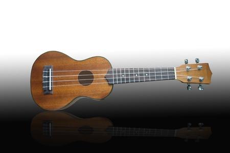 Ukulele guitar on black background  photo