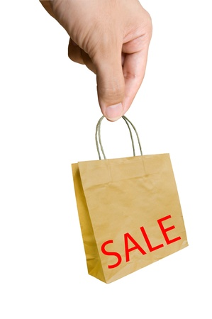 Sale -  hand pick shopping bags with sale written on them  Stock Photo