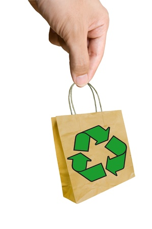 hand pick Shopping paper bag made from recycle paper with recycle symbol  Stock Photo