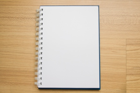 White blank page sketch book on wood photo
