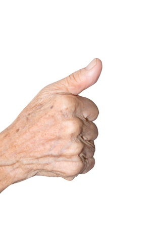 old woman hand  showing thumbs up sign against white background  photo