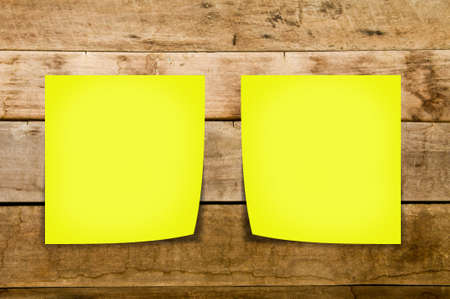 Yellow memo stick on old wood background Stock Photo - 13531344