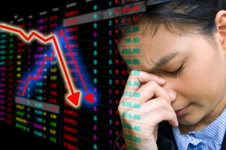 Business woman serious a falling graph of stock market