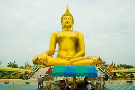 wat: Golden Buddha statue at Wat Muang temple in Angthong, Thailand Stock Photo