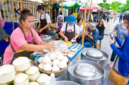 Street Coconut Juice vendor in a weekend bazaar in Chatuchak Market, Bangkok Editorial