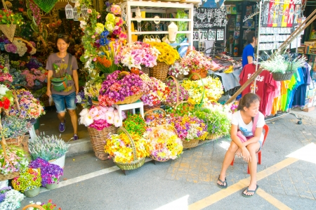 Street flowers vendor in a weekend bazaar Chatuchak Market, Bangkok