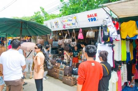Tourist shopping in Chatuchak weekend market Bangkok, Thailand
