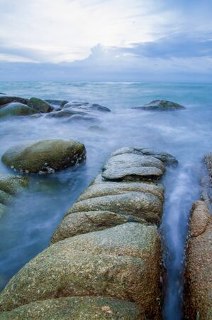 Sea waves impact rock on the beach, Thailand photo