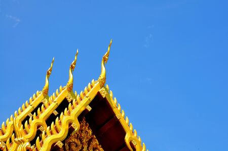 The Beautiful roof of temple on blue sky background photo
