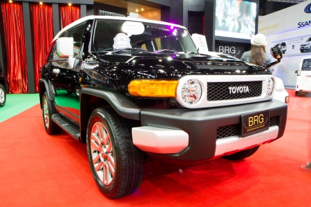 Bangkok - December 9   TOYOTA FJ Cruiser 4X4 Car Import by BRG at The 30th Thailand International Motor Expo on December 9, 2013 in Bangkok, Thailand