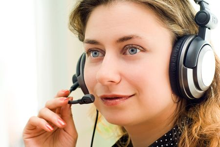 Close-up of smiling woman in a customer support photo