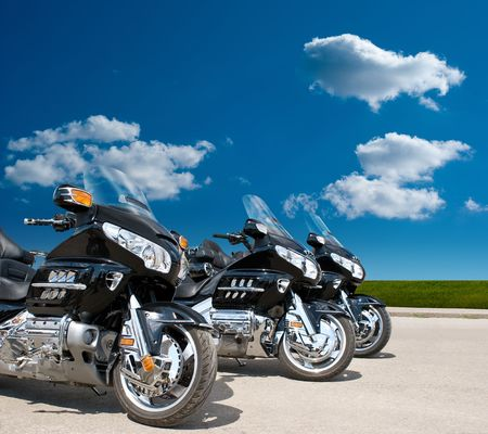 front view of Three Motorcycles on a road