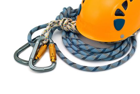 Isolated new climbing equipment - carabiners without scratches, yellow helmet and rope photo