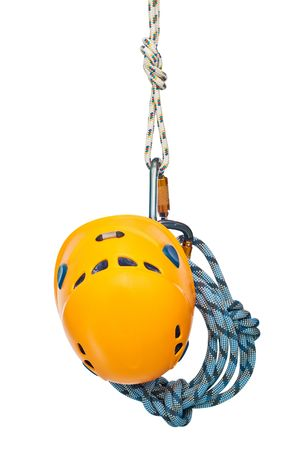 Isolated new climbing equipment - carabiners without scratches, yellow helmet and rope