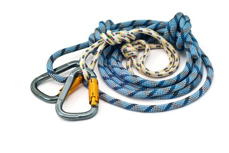 belaying: Isolated new climbing equipment - carabiners without scratches and blue rope