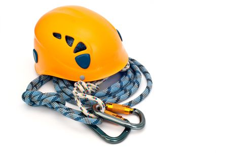 climbing sport: Isolated new climbing equipment - carabiner without scratches, orange helmet and blue rope Stock Photo