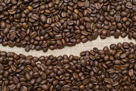 coffee grains on a burlap texture background