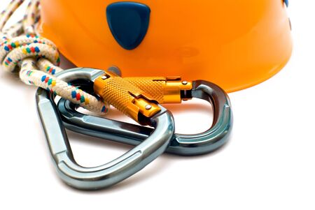 two alpinism carabiners and orange helmet photo