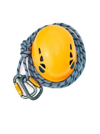 rapell: Isolated new climbing equipment - carabiners without scratches, orange climbing helmet and blue rope Stock Photo