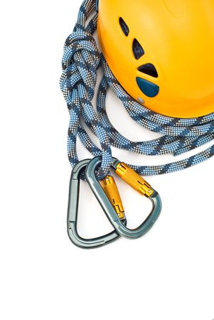 Isolated new climbing equipment - carabiners, helmet and rope