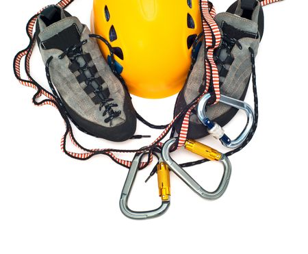 climbing gear - carabiners, orange helmet, rope, grey shoes