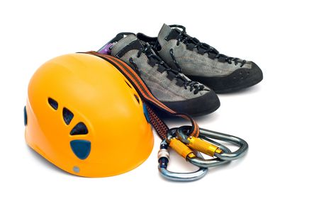 alpinism: climbing gear - carabiners, orange helmet, rope, grey shoes