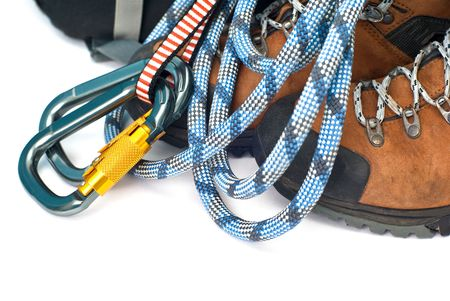 climbing and hiking gear - two carabiners, blue rope and leather brown boots Stock Photo - 5637511