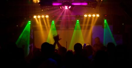 hands at rock concert, silhouettes against stage lighting Stock Photo - 5859276