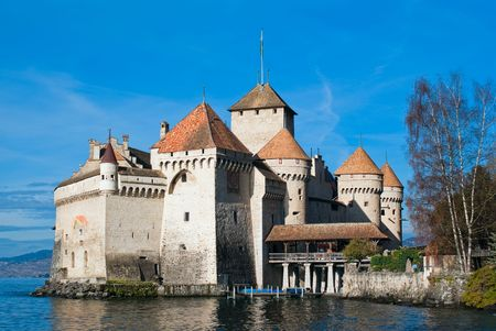 chillon: The Chillon Castle (Chateau de Chillon) is located on the shore of Lake Geneva in the municipality of Veytaux, at the eastern end of the lake, 3 km from Montreux, Switzerland. It is the most visited historic monument in Switzerland!