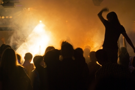 photo of silhouettes against stage lighting at rock concert photo