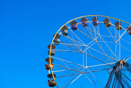 Ferris Wheel on a blue sky background photo