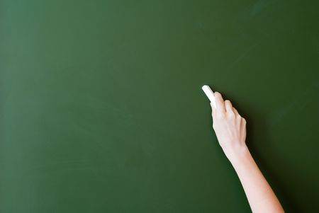hand writing by chalk on a blackboard Stock Photo