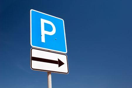 parking sign on a blue sky background
